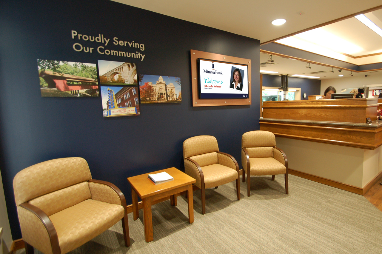 Minster Bank waiting room marketing campaign with interior matching backboard.