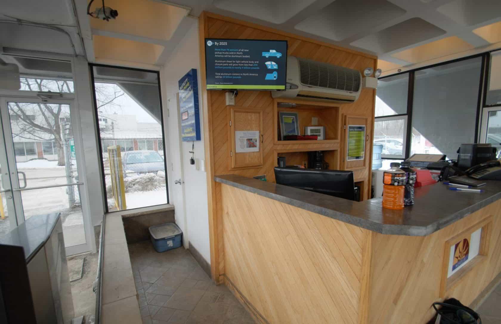 Manufacturing facility employee entrance guard shack.