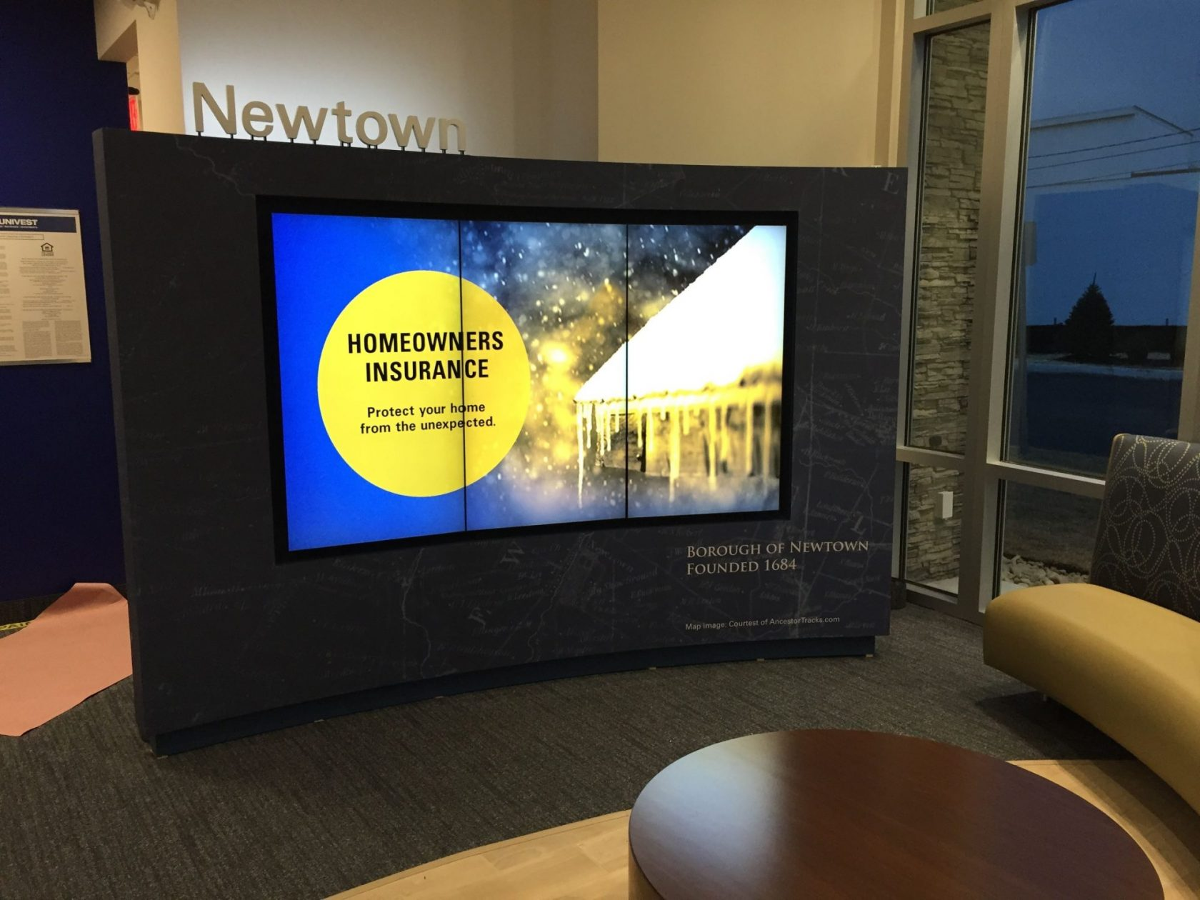 Newtown branded media wall with night time visibility.