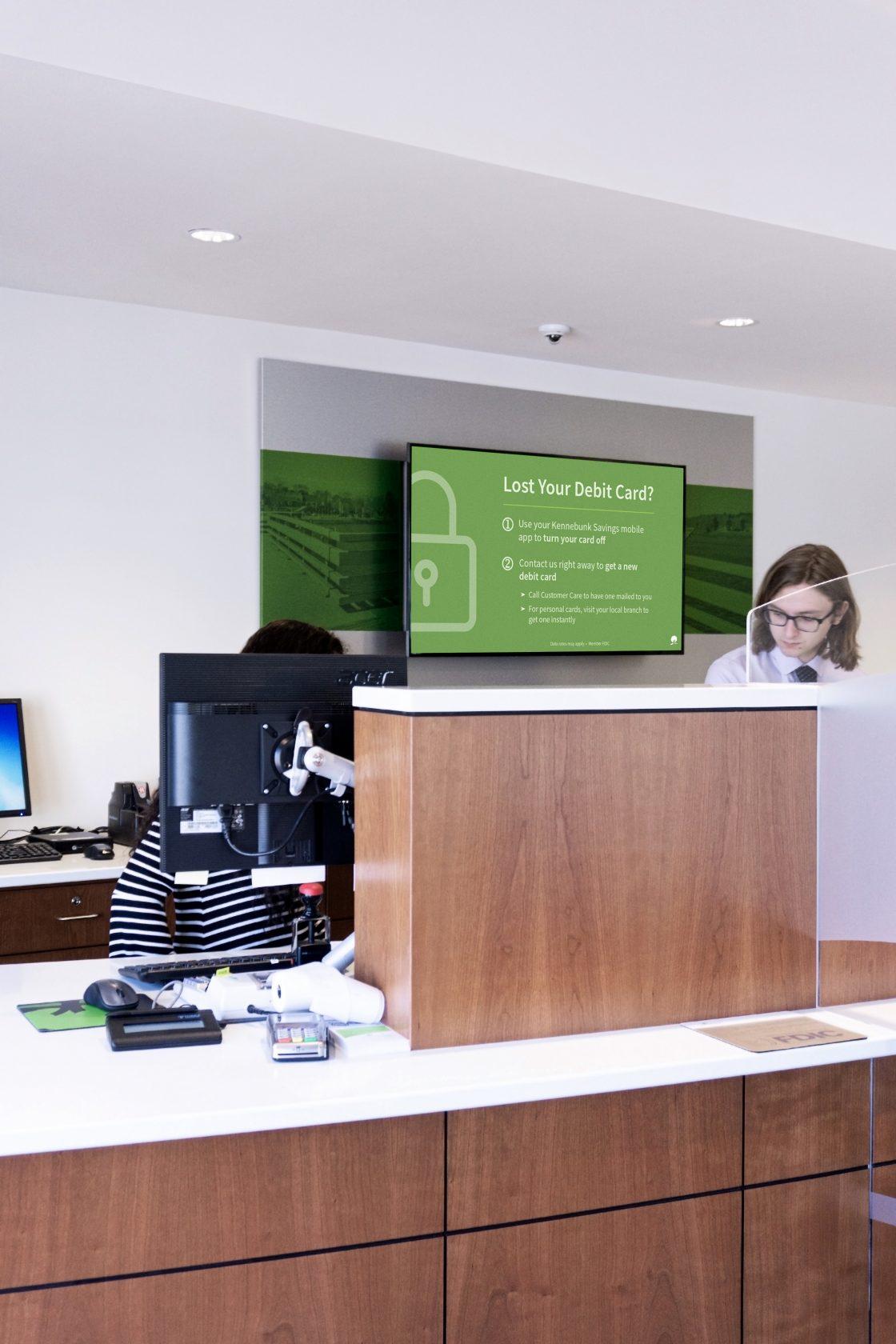 Digital displays convey relevant, local information behind a bank teller line