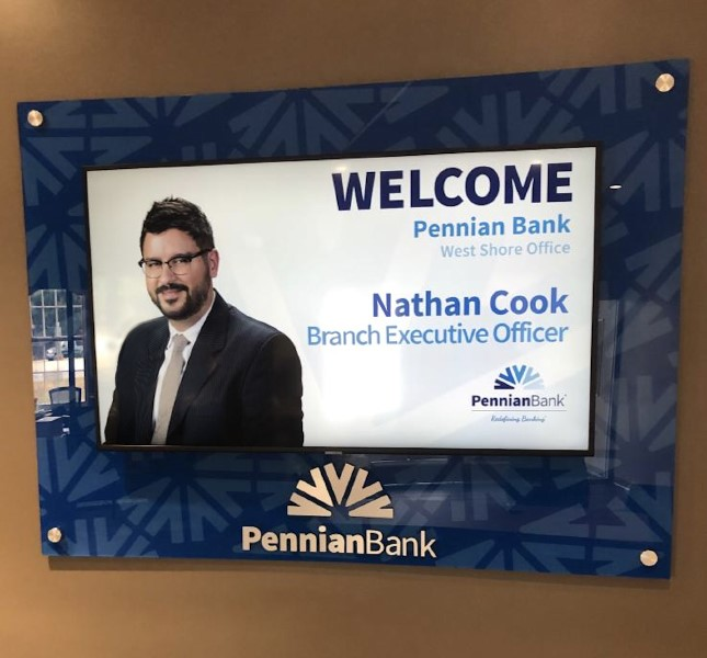 Pennian Bank used a custom backer board to add an additional brand element to their digital signs.