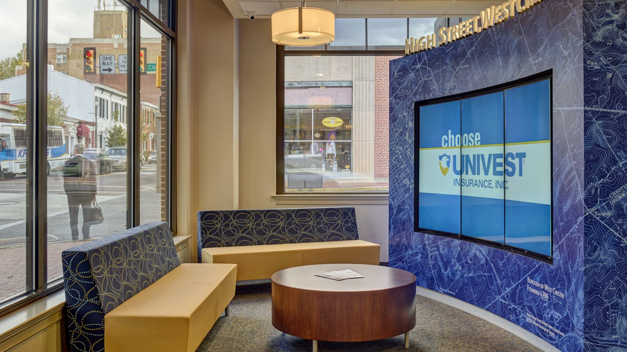 Univest video wall with small business spotlight message campaign.